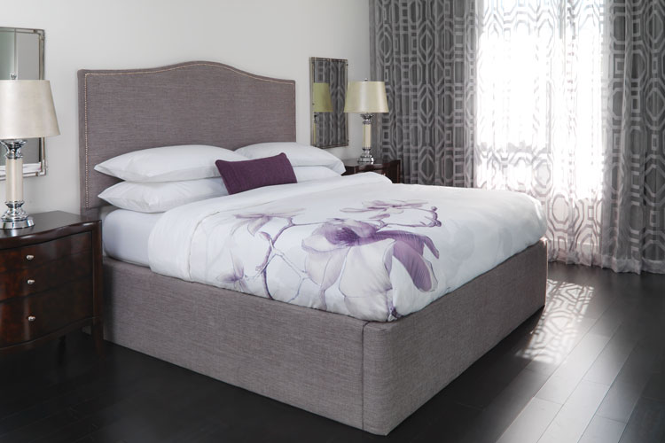A well made hotel bed featuring a Magnolia colored Circa Modular bed surround.
