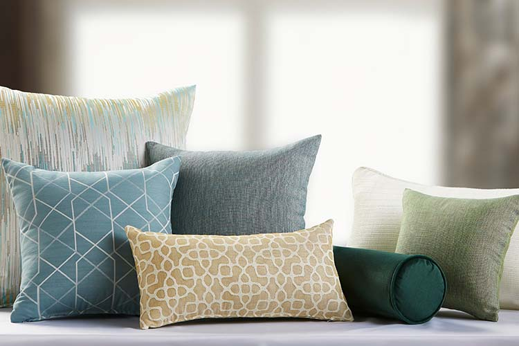 A group of decorative throw pillows featuring a variety of colors and patterns.