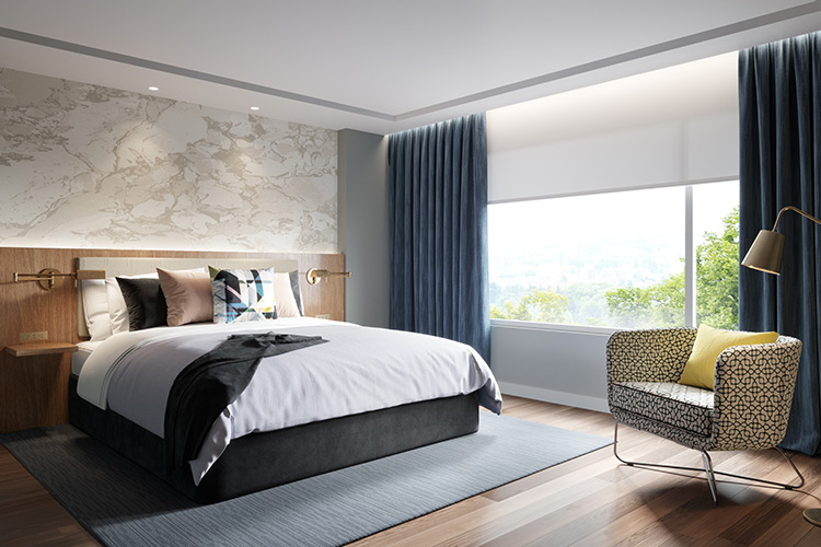 A luxury hotel room, featuring a well-made bed, custom printed wall covering, and a large window with stylish window treatments.