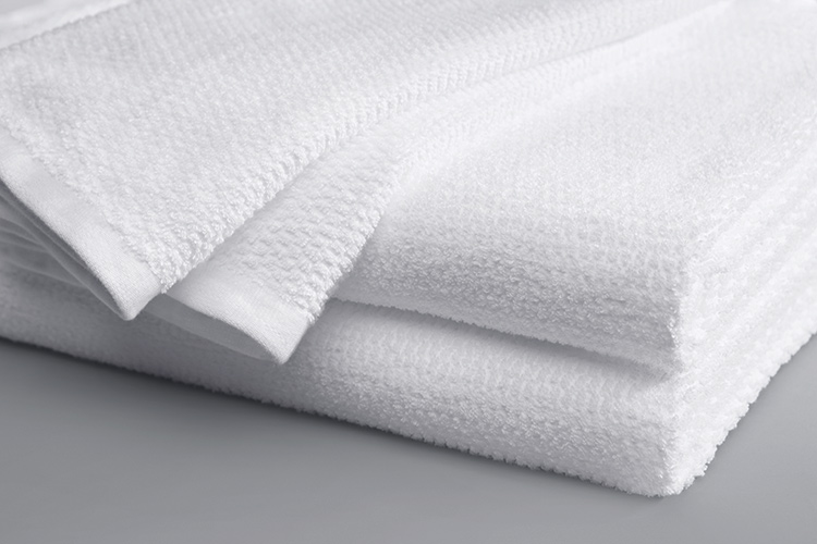 A folded Lynova blanket with edge detail in white.
