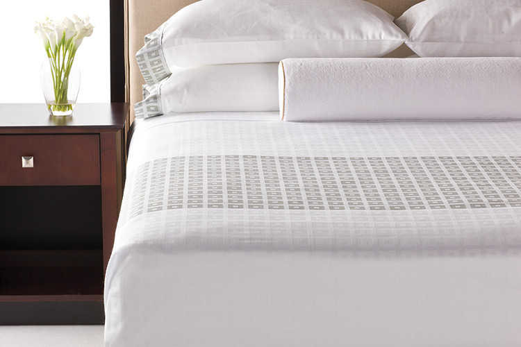 Hotel bed with fresh linens
