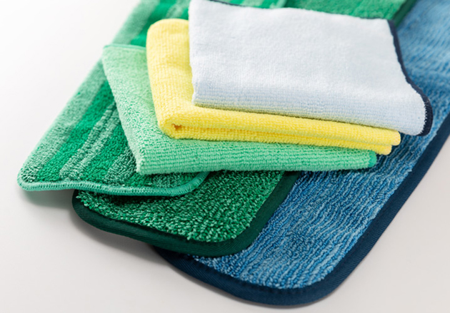 A stack of various size and color microfiber cleaning cloths.