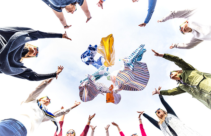 Group of people throwing hotel pool towels for wholesale in the air